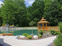 Gazebo and Waterfall. Cedar gazebo on concrete piers and 7' waterfall
