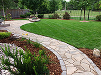 Backyard Walkway. Permacon Mega Arbel patio with Vendome Accents